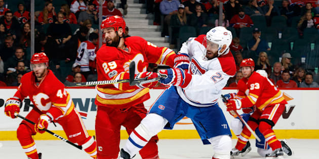 CALGARY, AB - MARCH 9: Deryk Engelland #29 of the Calgary Flames skates against Dwight King #21 of the Montreal Canadiens during an NHL game on March 9, 2017 at the Scotiabank Saddledome in Calgary, Alberta, Canada. (Photo by Gerry Thomas/NHLI via Getty Images)