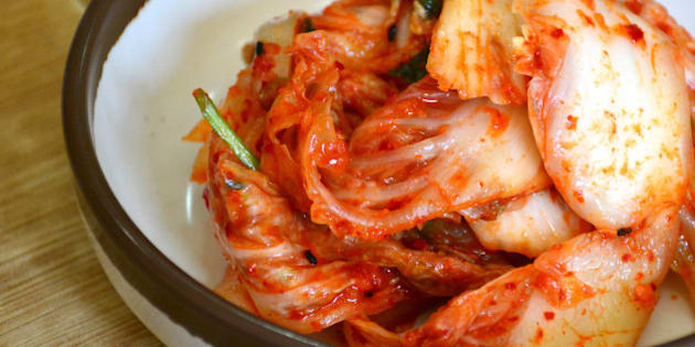 Close up cabbage kimchi on table.