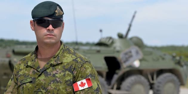 A Canadian military instructor looks on during Ukrainian military exercises at the International Peacekeeping and Security Center in Yavoriv, near Lviv, on July 12, 2016. / AFP / Yuriy Dyachyshyn        (Photo credit should read YURIY DYACHYSHYN/AFP/Getty Images)