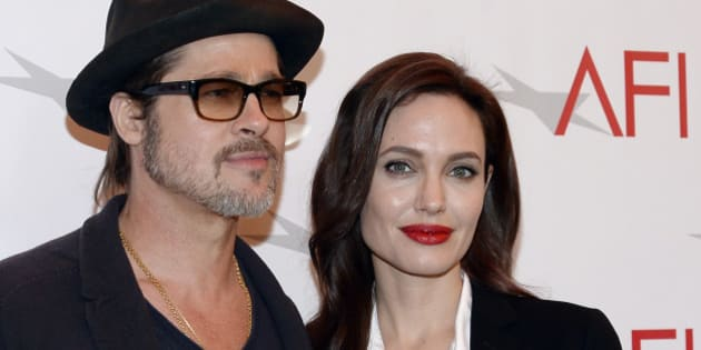 Actor Brad Pitt and actress/director Angelina Jolie pose at the AFI Awards 2014 honoring excellence in film and television in Beverly Hills, California, U.S. on January 9, 2015. REUTERS/Kevork Djansezian/File Photo