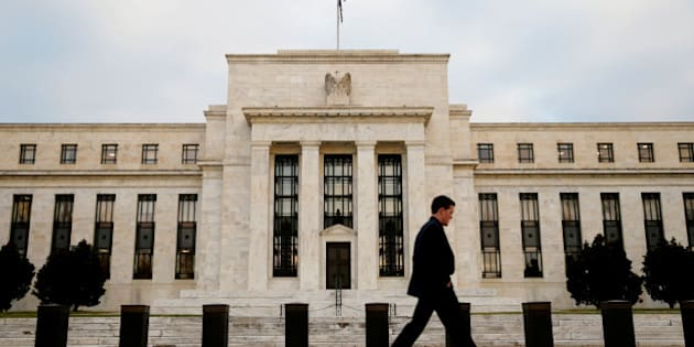 FILE PHOTO: A man walks past the Federal Reserve Bank in Washington, D.C., U.S. December 16, 2015.   REUTERS/Kevin Lamarque/File Photo            GLOBAL BUSINESS WEEK AHEAD PACKAGE Ð SEARCH BUSINESS WEEK AHEAD MARCH 13 FOR ALL IMAGES