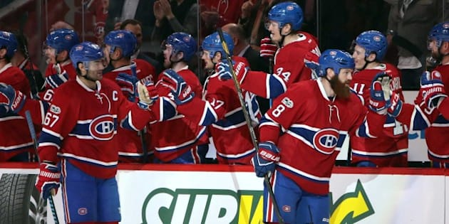Mar 19, 2017; Montreal, Quebec, CAN; Montreal Canadiens defenseman Jordie Benn (8) celebrates his goal against Ottawa Senators with teammates during the first period at Bell Centre. Mandatory Credit: Jean-Yves Ahern-USA TODAY Sports