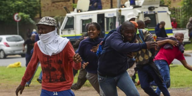 PRETORIA, SOUTH AFRICA  FEBRUARY 24: (SOUTH AFRICA OUT): Protesters and police clash during the Foreign March where South Africans from different areas protested against illegal immigrants on February 24, 2017 in Pretoria, South Africa. Police fired rubber bullets and stun grenades to control the situation. (Photo by Alet Pretorius/Gallo Images/Getty Images)