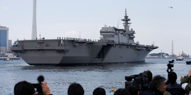 Japan Maritime Self-Defense Force's (JMSDF) latest Izumo-class helicopter carrier DDH-184 Kaga leaves a port after a handover ceremony for the JMSDF by Japan Marine United Corporation in Yokohama, Japan March 22, 2017.   REUTERS/Toru Hanai