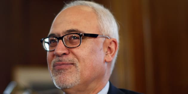 Quebec's Minister of Finance Carlos Leitao smiles during a photo-op at his office in Quebec City, June 3, 2014. Leitao will table his provincial budget on June 4. REUTERS/Mathieu Belanger (CANADA - Tags: POLITICS)