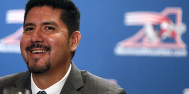 Montreal Alouettes quarterback Anthony Calvillo laughs with the media after he announced his retirement from CFL football in Montreal, January 21, 2014.  REUTERS/Christinne Muschi (CANADA - Tags: SPORT FOOTBALL)