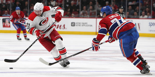 Mar 23, 2017; Montreal, Quebec, CAN; Carolina Hurricanes right wing Lee Stempniak (21) skates with the puck as Montreal Canadiens defenseman Alexei Emelin (74) defends during the second period at Bell Centre. Mandatory Credit: Jean-Yves Ahern-USA TODAY Sports