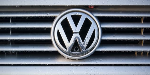 'Padua, Italy - July 6, 2011: Wet Volkswagen metallic logo on a car hood. Volkswagen is a German, world famous, motor vehicles manufacturer brand which also owns the Audi, Bentley, Bugatti, Lamborghini, SEAT, and A koda marques. The world Volkswagen means -people car- in German.'
