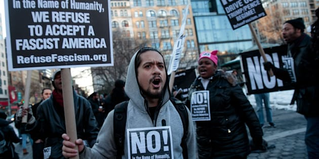 NEW YORK, NY - MARCH 16: Demonstrators rally during a small protest of President Donald Trump's proposed travel ban and suspension of the country's refugee program, March 16, 2017 in New York City. On Wednesday night, a federal judge in Hawaii issued a temporary restraining order on President Trump's second version of the executive order, which restricts entry to the U.S. for people from six Muslim-majority countries. (Photo by Drew Angerer/Getty Images)