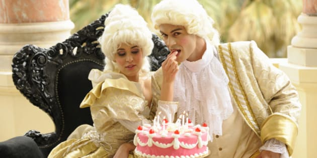 Marie Antoinette feeding her king with her birthday cake