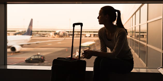 Woman waiting for her flight.