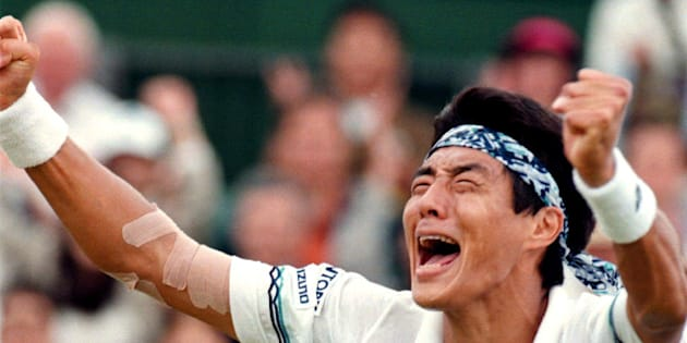 Japan's Shuzo Matsuoka celebrates his victory in the fourth round of the Wimbledon tennis championships July 3