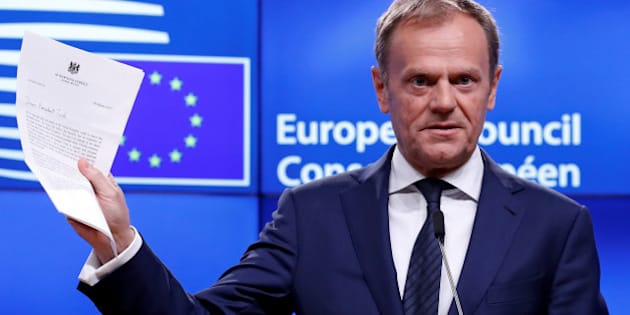 European Council President Donald Tusk shows British Prime Minister Theresa May's Brexit letter in notice of the UK's intention to leave the bloc under Article 50 of the EU's Lisbon Treaty, at the end of a news conference in Brussels, Belgium March 29, 2017. REUTERS/Yves Herman     TPX IMAGES OF THE DAY