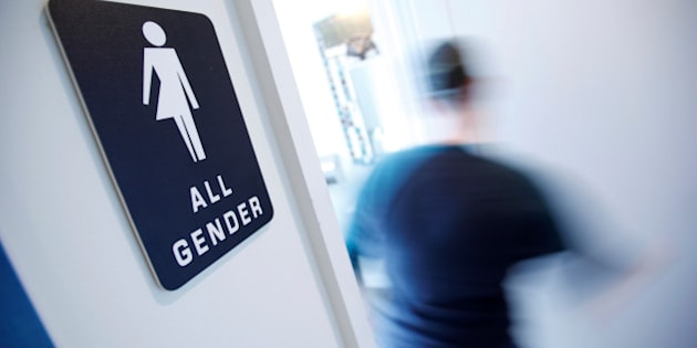 """A bathroom sign welcomes both genders at the Cacao Cinnamon coffee shop in Durham, North Carolina May 3, 2016. The shop installed the signs after North Carolina's """"bathroom law"""" gained national attention, positioning the state at the center of a debate over equality, privacy and religious freedom.   REUTERS/Jonathan Drake"""