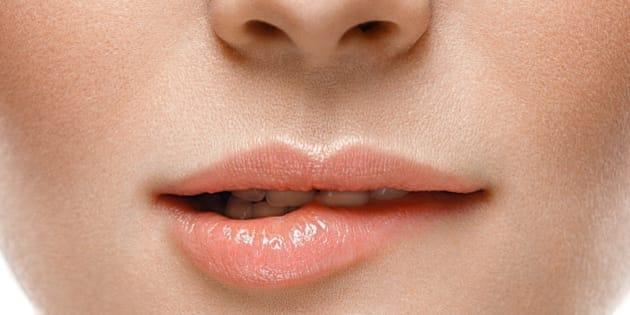 Healthy Smile. Woman Smile Closeup. Beautiful Lips Healthy skin concept. Studio shot.