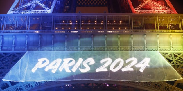 PARIS, FRANCE - FEBRUARY 03:  The Eiffel tower is lit with the colours of the Olympic flag with the words 'Paris 2024' during the launch of the international campaign for the 2024 Olympic Games on February 3, 2017 in Paris, France. The city of Paris is candidate to host the Olympic Games in 2024.  (Photo by Chesnot/Getty Images)