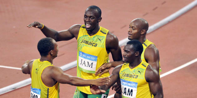 Jaimaican team with Asafa Powell,Usain Bolt, Michael Frater and Nesta Carter. (Photo by Eddy LEMAISTRE/Corbis via Getty Images)