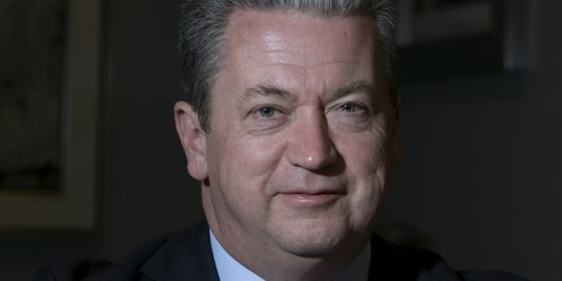 """Neil Bruce, president and CEO of SNC-Lavalin, poses in their head offices in Montreal, November 10, 2015. Bruce said he expects """"flattish"""" revenues next year, as the engineering and construction company prepares to cut costs to help hit 2017 margin targets in a weaker economy. To match Interview SNC-LAVALIN-OUTLOOK/ REUTERS/Christinne Muschi"""