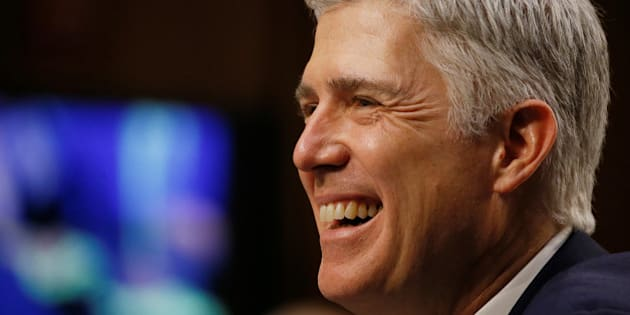 U.S. Supreme Court nominee judge Neil Gorsuch smiles in reaction to a question as he testifies during the third day of his Senate Judiciary Committee confirmation hearing on Capitol Hill in Washington, U.S., March 22, 2017. REUTERS/Jim Bourg