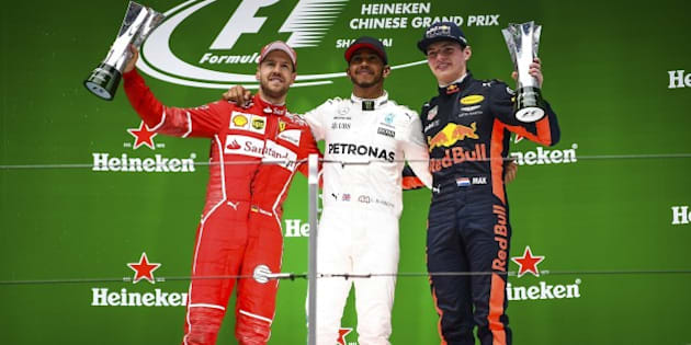 SHANGHAI, CHINA - APRIL 09: Race winner Lewis Hamilton (C) of Great Britain and Mercedes GP with second placed finisher Sebastian Vettel (L) of Germany and Ferrari and third placed finisher Max Verstappen (R) of Netherlands and Red Bull Racing on the podium during the Formula One Grand Prix of China at Shanghai International Circuit on April 9, 2017 in Shanghai, China.  (Photo by Stringer/Anadolu Agency/Getty Images)