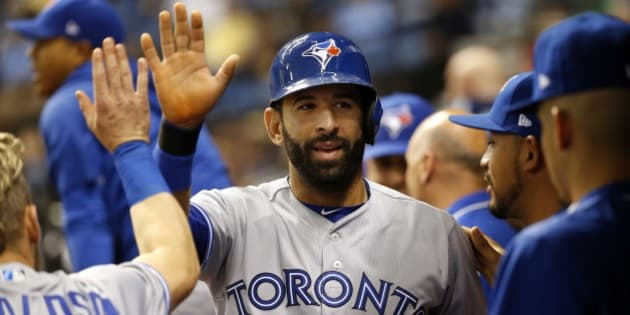 Apr 7, 2017; St. Petersburg, FL, USA; Toronto Blue Jays right fielder Jose Bautista (19) celebrates with teammates in the dugout after scoring during the fifth inning against the Tampa Bay Rays at Tropicana Field. Mandatory Credit: Kim Klement-USA TODAY Sports