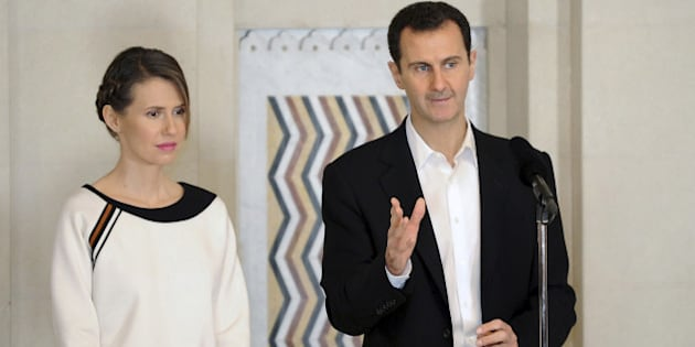 """Syria's President Bashar al-Assad stands next to his wife Asma, as he addresses injured soldiers and their mothers during a celebration marking Syrian Mother's Day in Damascus, in this handout picture provided by SANA on March 21, 2016. SANA/Handout via REUTERS  ATTENTION EDITORS - THIS IMAGE WAS PROVIDED BY A THIRD PARTY. EDITORIAL USE ONLY. REUTERS IS UNABLE TO INDEPENDENTLY VERIFY THIS IMAGE  SEARCH """"ALEPPO TIMELINE"""" FOR THIS STORY"""