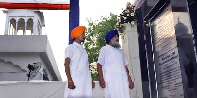 NEW DELHI, INDIA - JUNE 12: Devotees look at just laid foundation stone of November 1984 Sikh Genocide Memorial at Gurudwara Rakab Ganj on June 12, 2013 in New Delhi, India. Allegedly more than 8,000 Sikhs died including 3,000 in Delhi during the 1984 anti-Sikhs riots or the 1984 Sikh Massacre by anti-Sikh mobs, in response to the assassination of Indira Gandhi by her Sikh bodyguards. (Photo by Vipin Kumar/Hindustan Times via Getty Images)