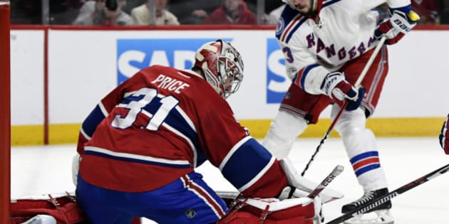 Apr 20, 2017; Montreal, Quebec, CAN; Montreal Canadiens goalie Carey Price (31) makes a save against New York Rangers forward Mika Zibanejad (93) during the second period in game five of the first round of the 2017 Stanley Cup Playoffs at the Bell Centre. Mandatory Credit: Eric Bolte-USA TODAY Sports