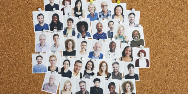 Grid of multi-ethnic portraits stuck to cork board representing community and our social and professional networks