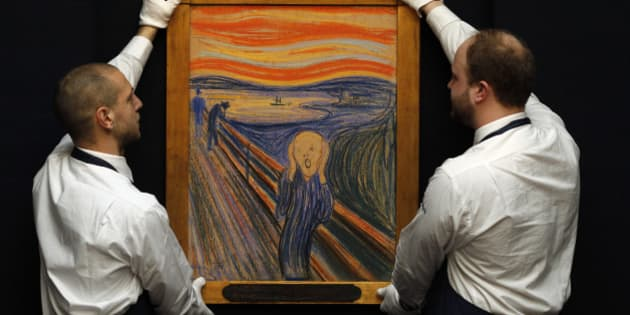 "Sotheby's employees pose for a photograph with Edvard Munch's painting ""The scream"" at Sotheby's auction house in London April 12, 2012. The painting, estimated to exceed $80 million (50.2 million pounds), will be sold in New York on May 2, 2012.     REUTERS/Stefan Wermuth (BRITAIN - Tags: ENTERTAINMENT SOCIETY)"