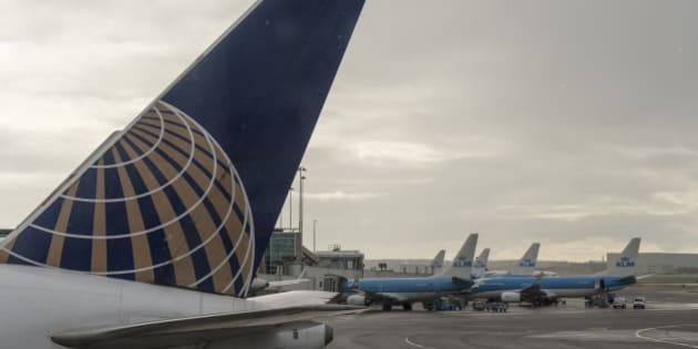 AMSTERDAM, NETHERLANDS - APRIL 23: A United Airlines and several KLM airplanes are parked on the tarmac in Schiphol Airport on April 23, 2017 in Amsterdam, Netherlands. Schiphol is the main international airport of the Netherlands. It is the third busiest airport in Europe in terms of passengers, and the hub for KLM and its regional affiliate KLM Cityhopper as well as for Corendon Dutch Airlines, Martinair, Transavia and TUI fly Netherlands. The airport also serves as a European hub for Delta Air Lines and Jet Airways and as a base for EasyJet and Vueling. (Photo by Horacio Villalobos - Corbis/Corbis via Getty Images)