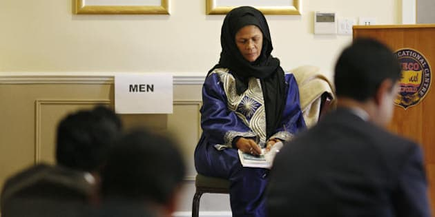 US professor Amina Wadud (Facing) prepares her sermon before leading Friday prayers for men and women at the Oxford Centre in Oxford, in southern England, on October 17, 2008. AFP PHOTO/Adrian Dennis (Photo credit should read ADRIAN DENNIS/AFP/Getty Images)
