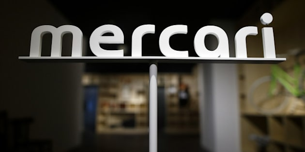 Logo of Mercari Inc. is displayed at the entrance to the company's office in Tokyo, Japan, on Friday, March 11, 2016. Mercari, a mobile e-commerce site that matches individual buyers and sellers, this month became the first Japanese startup worth at least $1 billion. Photographer: Tomohiro Ohsumi/Bloomberg via Getty Images