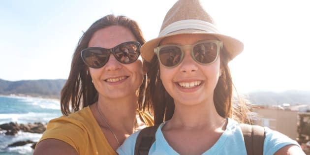 Photo of mother and daughter taking summer selfie