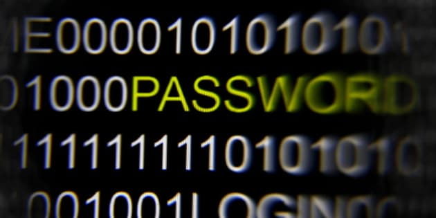 The word 'password' on a computer screen is magnified with a magnifying glass in this picture illustration taken in Berlin May 21, 2013. The Financial Times' website and Twitter feeds were hacked May 17, 2013, renewing questions about whether the popular social media service has done enough to tighten security as cyber-attacks on the news media intensify. The attack is the latest in which hackers commandeered the Twitter account of a prominent news organization to push their agenda. Twitter's 200 million users worldwide send out more than 400 million tweets a day, making it a potent distributor of news. REUTERS/Pawel Kopczynski   (GERMANY - Tags: CRIME LAW SCIENCE TECHNOLOGY)