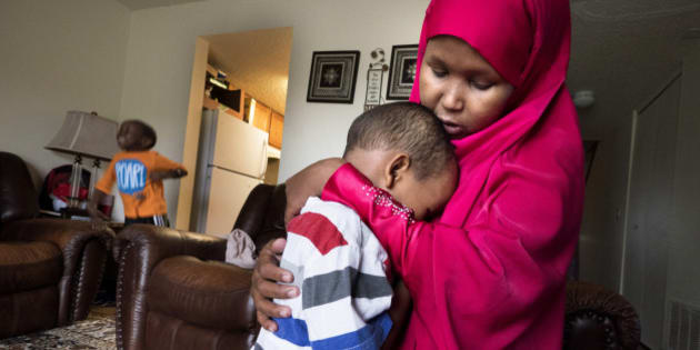 HOPKINS, MN - APRIL, 27: Suaado Salah comforts her son Luqman, 3, at their apartment in Hopkins, Minn., Thursday April 27, 2017. Luqman and his 18-month-old sister got the measles during the current outbreak in Minneapolis and are now fully healing at home. Brother Abdullahi, 5, left, did not get sick and has now been vaccinated. Salah had previously refused the MMR shot for them because of rumors that it caused autism. She has since changed her mind and is upset that the connection is still being touted by anti-vaxxers. (Photo by Courtney Perry/For the Washington Post)
