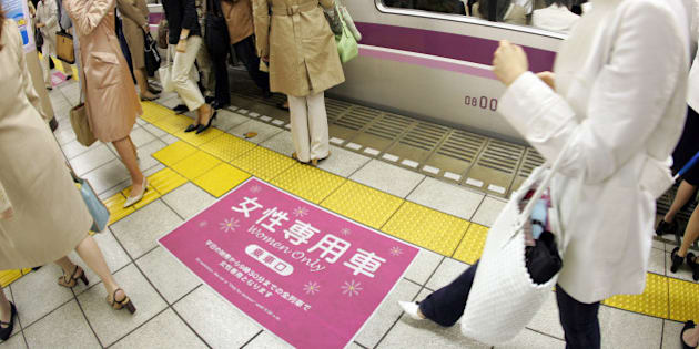 TOKYO, JAPAN - MAY 11:  Female passengers come out from a 'Women Only' carriage at a metro station May 11, 2005 in Tokyo, Japan. Nine private railways and subway trains operated by the Tokyo metropolitan government began running 'Women Only' carriages during the morning hours in order to prevent railway gropers in crowded trains.  (Photo by Junko Kimura/Getty Images)