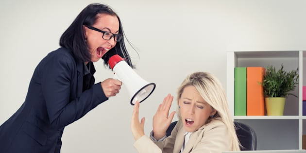 Mad boss yelling at employee on megaphone