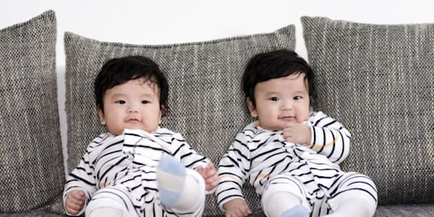 five months old  asian twins