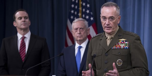 US Secretary of Defense Jim Mattis (C), Chairman of the Joint Chiefs of Staff Marine General Joseph Dunford (R) and Brett McGurk (L), Special Presidential Envoy for the Global Coalition to Counter ISIS, hold a press briefing at the Pentagon in Washington, DC, May 19, 2017.