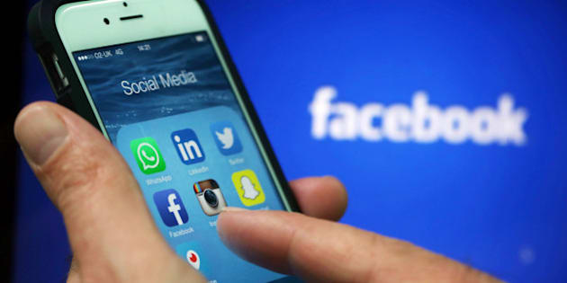 Social media apps including WhattsApp, LinkedIn, Twitter, FaceBook, Instagram, SnapChat and Periscope are displayed in a social media folder on the screen of an Apple Inc. iPhone 6 in this arranged photograph taken in London, U.K., on Friday, May, 15, 2015. Facebook Inc. reached a deal with New York Times Co. and eight other media outlets to post stories directly to the social network's mobile news feeds, as publishers strive for new ways to expand their reach. Photographer: Chris Ratcliffe/Bloomberg via Getty Images