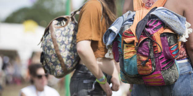 GLASTONBURY, ENGLAND - JUNE 27:  Festival goers wearing backpacks at the Glastonbury Festival at Worthy Farm, Pilton on June 27, 2015 in Glastonbury, England.  (Photo by Daniel Sims/Getty Images)