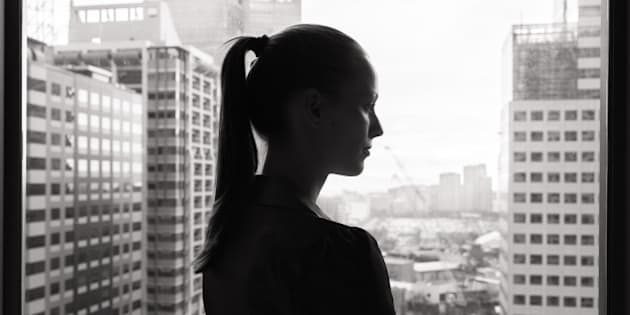 Thoughtful young business woman (black and white portrait).