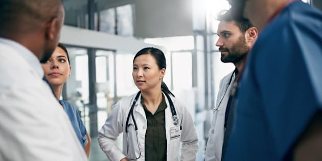 Shot of a diverse team of doctors having a discussion