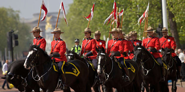 Royal Canadian Mounted Police (RCMP) parade down the Mall in central London, on May 23, 2012, as they prepare to take part in the 'Changing of the Guard' ceremony. Their participation is part of the Queen's Diamond Jubilee celebrations and will also feature women for the first time.  AFP PHOTO / Andrew Cowie        (Photo credit should read Andrew Cowie/AFP/GettyImages)