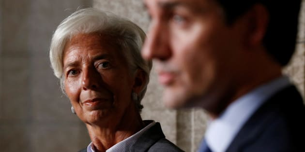 International Monetary Fund (IMF) Managing Director Christine Lagarde (L) listens to Canada's Prime Minister Justin Trudeau during a news conference on Parliament Hill in Ottawa, Ontario, Canada, September 13, 2016. REUTERS/Chris Wattie