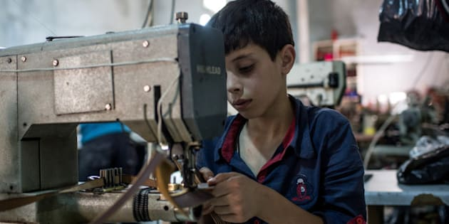 GAZIANTEP, TURKEY - MAY 16:  A young Syrian refugee boy makes shoe parts in a Turkish owned factory on May 16, 2016 in Gaziantep, Turkey. Since fleeing the war and after the new E.U - Turkey deal effectively shutting down routes to Europe for many Syrian refugees, living in Turkey has become their only option, however there is very little stable work and little hope of building a future. Turkey's massive and largely unregulated garment industry is an attractive option for Syrians to work both legally and illegally despite low wages, long hours and poor conditions. It is a popular choice for Syrians living outside of the official refugee camps, who are offered no assistance from the state. Child labour amongst Syrian refugees is also a major concern, with children between the ages of 7-10yrs often working in clothing and shoe factories on shifts longer than 10 hours, earning them approximately 400TL per month (135USD) well below the Turkish minimum wage of 1,647TL a month (554USD). For many children working in garment factories is their only choice as many have lost their father's, uncles, and brothers to the war and now find themselves as the head of the family, forced to earn money to provide for their families basic needs. Turkey's garment industry is a massive supplier to both Europe and the Middle East, as part of the E.U -Turkey deal it was announced that Syrians who had been in the country for more than six months would be able to apply for a work permit allowing them to receive the minimum wage and some work benefits, which would aim at protecting workers from discrimination.  (Photo by Chris McGrath/Getty Images)