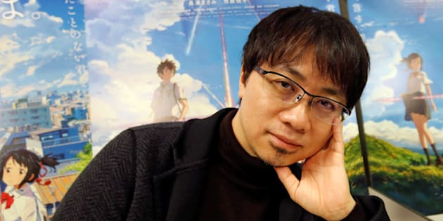 Japanese anime director Makoto Shinkai poses for a photo in front of posters of his animated film 'Your Name' after an interview with Reuters in Tokyo, Japan, November 16, 2016. Picture taken November 16, 2016.    REUTERS/Toru Hanai