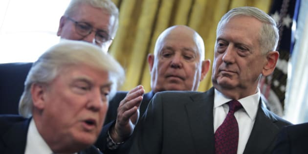 U.S. Defense Secretary James Mattis looks at U.S. President Donald Trump as he speaks during a meeting with Medal of Honor recipients in the Oval Office of the White House in Washington, U.S., March 24, 2017. REUTERS/Carlos Barria
