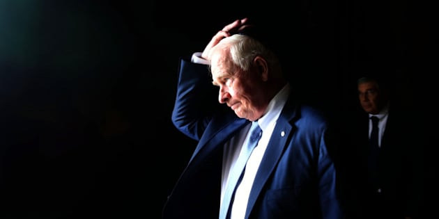 Canadian Governor General of Canada David Johnston adjusts his kippa on November 2, 2016 during a visit to the Yad Vashem Holocaust Memorial museum in Jerusalem commemorating the six million Jews killed by the Nazis during World War II. AFP PHOTO/GALI TIBBON / AFP / GALI TIBBON        (Photo credit should read GALI TIBBON/AFP/Getty Images)